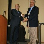 Carl Mathis with Power Sales receiving the Happy Trails Award