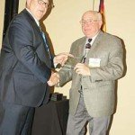 Carroll Hollingsworth with D H Marketing receiving the CMA Service Award