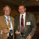 Larry Weber and Tom Boyle with their golf trophies